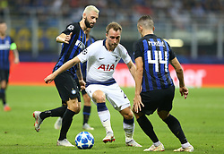 September 18, 2018 - Milan, Italy - FC Internazionale Milano v Tottenham Hotspur FC - UEFA Champions League Group B..Christian Eriksen of Tottenham Hotspur between Marcelo Brozovic of FC Internazionale and Ivan Perisic of FC Internazionale  at San Siro Stadium in Milan, Italy on September 18, 2018. (Credit Image: © Matteo Ciambelli/NurPhoto/ZUMA Press)