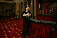 Vice President Dick Cheney reads notes in the Old Senate Chambers on January 6, 2009. Photo by Dennis Brack