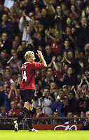 Photo. Jed Wee.<br /> Manchester United v Dinamo Bucharest, UEFA Champions League Qualifying 2nd Leg, 24/08/2004.<br /> Manchester United's Alan Smith leaves the field with the match won to a raptuous round of applause