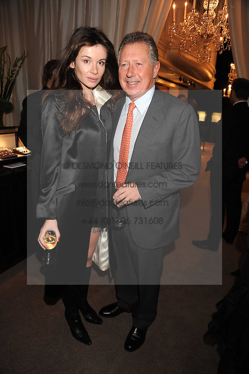RICHARD NORTHCOTT and JOANNE KERPIUS at a party to celebrate the launch of the Raffles Asprey Cocktail, held at Asprey, New Bond Street, London on 13th November 2008.