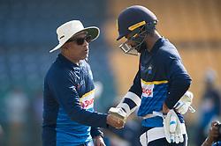 December 28, 2017 - Colombo, Western Province, Sri Lanka - Sri Lanka new head coach Chandika Hathurusingha (L) giving some in form batsman Upul Tharanga (R) during the first practices session (Credit Image: © Sameera Peiris/Pacific Press via ZUMA Wire)