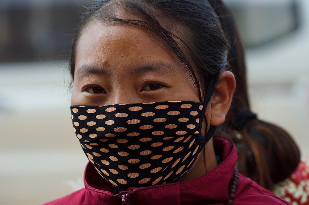 Tibetan woman in Zhidua wearing a face mask, Tibetan Plateau, Qinghai, China