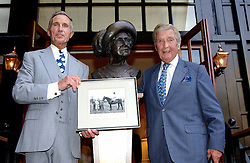 Left to right, GEORGE GORING and Writer DICK FRANCIS unveils a bust of the Late Queen Elizabeth The Queen Mother at a garden party at the Goring Hotel, Beeston Palce, London SW1 to celebrate the unveiling of a bronze bust the late Queen Elizabeth the Queen Mother on 20th July 2004.