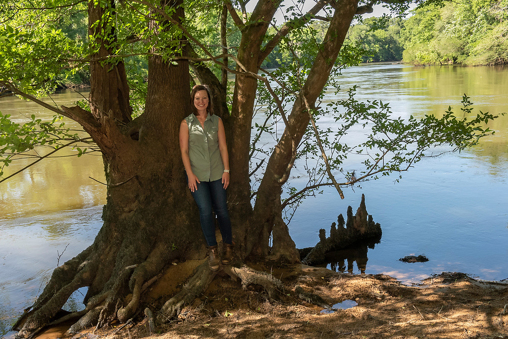 Casey Cox on the banks of the Flint RIver. Casey grew up boating on the river and she talks about it like it is a member of the family.