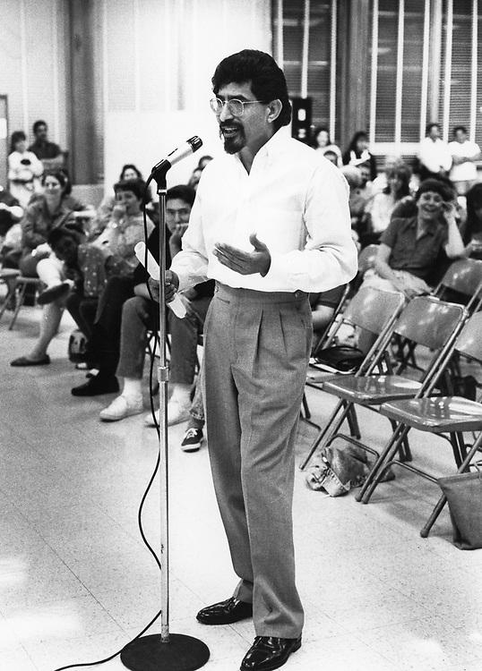 ©1989 Hispanic local activist Paul Hernandez testifying at school board about redistricting efforts, Austin, TX