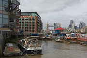 Private boats and miscellaneous water vessels at Tower Bridge Moorings, on 6th September 2017, in London, England.