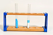 Hydrated Copper Sulphate in left hand tube (blue) and un-hydrated copper sulphate in right hand tube (white) Adding water to de-hydrated copper sulphate. Water being added to a test tube containing de-hydrated (anhydrous) copper (II) sulphate (CuSO4, white). The copper (II) sulphate forms hydration bonds with the water in an exothermic (heat-producing) reaction, resulting in hydrated copper (II) sulphate (blue).
