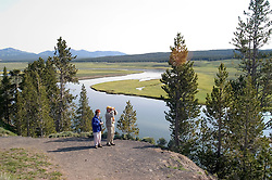 WY: Wyoming, Yellowstone National Park:.Couple at Grizzly Overlook in Hayden Valley..Model Released..Photo #: yellow1084..Photo copyright Lee Foster, 510/549-2202, lee@fostertravel.com, www.fostertravel.com..