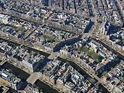 Nederland, Noord-Holland, Amsterdam; 23-03-2020; overzicht binnenstad Amsterdam, Raadhuisstraat richting Westermarkt.<br /> Het publieke leven in het centrum van de hoofdstad is bijna geheel stil komen te liggen als gevolg van het Corona virus. Niet alleen is alle horeca dicht, ook veel winkels en andere bedrijven zijn gesloten. Het publiek blijft over het algemeen binnen, de straten en pleinen zijn verlaten, nauwelijks verkeer.<br /> Innercity Amsterdam, Public life in the center of the capital has come to a complete standstill as a result of the Corona virus. Not only are all pubs, coffee shops and restaurants,  closed, many shops and other companies are also closed. The public generally stays inside, the streets and squares are deserted, hardly any traffic.<br /> luchtfoto (toeslag op standaard tarieven);<br /> aerial photo (additional fee required)<br /> copyright © 2020 foto/photo Siebe Swart