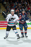 KELOWNA, CANADA - MARCH 26: Dawson Davidson #38 of Kamloops Blazers checks Rourke Chartier #14 of Kelowna Rockets on March 26, 2016 at Prospera Place in Kelowna, British Columbia, Canada.  (Photo by Marissa Baecker/Shoot the Breeze)  *** Local Caption *** Dawson Davidson; Rourke Chartier;