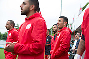 Northern Cyprus team mates watch from the den. Northern Cyprus 3 v Padania 2 during the Conifa Paddy Power World Football Cup semi finals on the 7th June 2018 at Carshalton Athletic Football Club in the United Kingdom. The CONIFA World Football Cup is an international football tournament organised by CONIFA, an umbrella association for states, minorities, stateless peoples and regions unaffiliated with FIFA.