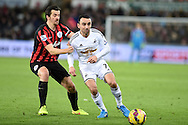 Leon Britton of Swansea city holds off Joey Barton of QPR (L). .Barclays Premier league match, Swansea city v Queens Park Rangers at the Liberty stadium in Swansea, South Wales on Tuesday 2nd December 2014<br /> pic by Andrew Orchard, Andrew Orchard sports photography.