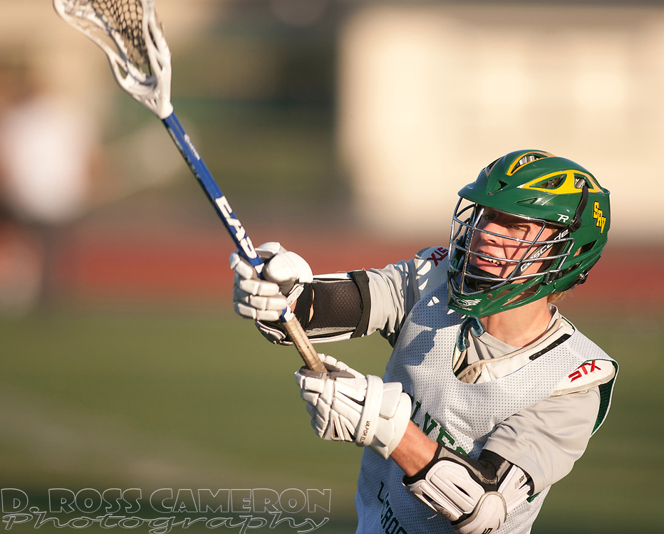 San Ramon Valley High School boys' lacrosse team attacker Austin French warms up with the team in preparation for their game Friday night against Monte Vista High School, Wednesday, May 6, 2015 in Danville, Calif. The team, which is top ranked in the North Coast Section, is dealing with the loss in January of Austin's father, assistant coach Todd French. (D. Ross Cameron/Bay Area News Group)