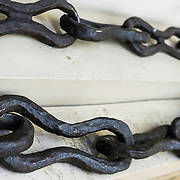 A section of the chain used across the Golden Horn during the 1453 siege of Istanbul as ordered by Byzantine Emperor Constantine XI, on display in the main building of the Istanbul Archaeology Museums. The Istanbul Archaeology Museums, housed in three buildings in what was originally the gardens of the Topkapi Palace in Istanbul, Turkey, holds over 1 million artifacts relating to Islamic art, historical archeology of the Middle East and Europe (as well as Turkey), and a building devoted to the ancient orient.