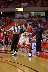 "31 January 2009: Osiris Eldridge looks for the next play under the scrutiny of referee Paul Janssen and coach Tim Jankovich. The Illinois State University Redbirds join the Bradley Braves in a tie for 2nd place in ""The Valley"" with a 69-65 win on Doug Collins Court inside Redbird Arena on the campus of Illinois State University in Normal Illinois"