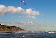 Kitesurfer flying with the birds