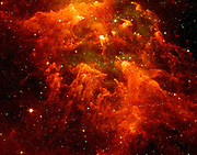 The 'South Pillar' region of the star-forming region called the Carina Nebula. This murky cloud to reveal star embryos tucked inside thick dust. Spitzer Space Telescope.