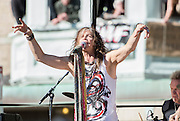 05 November 2012:  Aerosmith's Steven Tyler performs a free concert in Boston's Allston neighborhood in front of the apartment building, 1325 Commonwealth Ave, which was the band's home in the early 1970's.  Boston, MA. ***Editorial Use Only*****