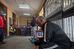 """Riedwann Blake, senior coordinator, inside the Masjidus Sabr mosque that has become headquarters for a joint, interfaith, Parkwood Covid-19 feeding response team. Volunteers today delivered bread to the community of Parkwood, a subburb of Cape Town, located on the Cape Flats, Monday, April 20, 2020. The majority of the people who live here are unemployed during """"normal"""" circumstances. And as South Africa is now in lockdown due to the Coronavirus, many of those who had jobs have also lost their income. So many people are starving. The feeding scheme is a joint community effort, paid for solely by donations from the public to feed more than 3,000 households. The group is also receiving transportation support by The South African Red Cross Society. """"In this community, it's a miracle, really, that we've taken charge. We only survive on the good will of the general public,"""" said Blake. PHOTO: EVA-LOTTA JANSSON"""