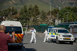 Personnel in protective clothing, emerging out of Western Cape government vehicles, arrive at the Safe Space, normally a transitional overnight shelter, in Cape Town, on Friday, April 24, 2020. The shelter is housing resident homeless people for the duration of the government-mandated lockdown in response to the Coronavirus.  PHOTO: EVA-LOTTA JANSSON