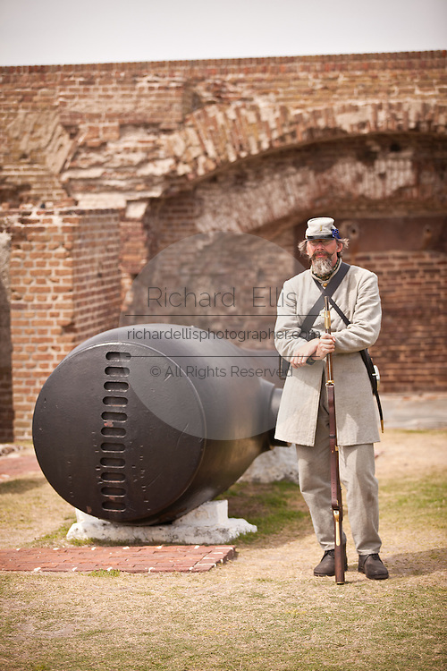 Confederate re-enactor stands guard at Fort Sumter as Union troops withdraw from the fort in a ceremony commemorating the surrender 150-years ago April 12, 2011 in Charleston, SC.  The re-enactors are part of the 150th commemoration of the US Civil War.