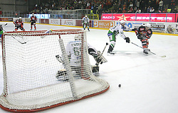Andrej Tavzelj and Tomaz Razingar at 2nd final match of Slovenian National Championships  between HK Acroni Jesenice and HDD Tilia Olimpija, on March 17, 2009, in Podmezaklja, Jesenice, Slovenia. Acroni Jesenice won after free shots 2:1 and are leading 2:0. They need to win 2-times more. (Photo by Vid Ponikvar / Sportida)