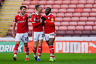 Mamadou Thiam of Barnsley (26) scores a goal and celebrates with Cauley Woodrow of Barnsley (25) and Daniel Pinillos of Barnsley (23) to make the score 2-0 during the EFL Sky Bet League 1 match between Barnsley and Charlton Athletic at Oakwell, Barnsley, England on 29 December 2018.