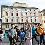 FLORENCE, ITALY - OCTOBER 31: Children react to a busker producing bubbles in the Piazza della Republica. Florence, Italy, 31st October 2017. Photo by Tim Clayton/Corbis via Getty Images)