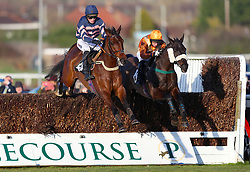 Micquus ridden by jockey James Best (right) jumps a fence on his way to winning the Strong Flavours Catering Novices Handicap Chase during Injured Jockeys Fund Charity Raceday at Plumpton Racecourse.
