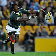"""Chiliboy Ralepelle passes from the base of the ruck late in the match for South Africa during action from the Tri-Nations Rugby Test Match played between Australia and South Africa at Suncorp Stadium (Brisbane, Australia) on Saturday 24th July 2010<br /> <br /> Conditions of Use : This image is intended for Editorial use only (news or commentary, print or electronic) - Required Images Credit """"Steven Hight - Auraimages/Photosport"""
