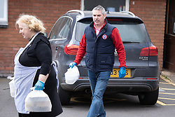 © Licensed to London News Pictures. 30/03/2020. Baddesley, North Warwickshire, UK. MP Delivery. Pictured Craig Tracey with Angie Spencer (left). North Warwickshire MP Craig Tracey turns delivery man to help deliver meals in his constituency. When Atherstone coffee shop owner Angie Spencer decided to make meals for people who were housebound she asked for volunteers to help deliver the meals. The local community responded along with local MP Craig Tracey. The meals will be delivered on Mondays and Fridays to start with, the first going out today (Monday 30th March) with over 100 meals being delivered. Angie has put out a request for more drivers should the need rise. Angie, a local town councillor started the idea along with business partner Stephen Reay and asked Warwickshire County Council to help with the scheme. Photo credit: Dave Warren / LNP
