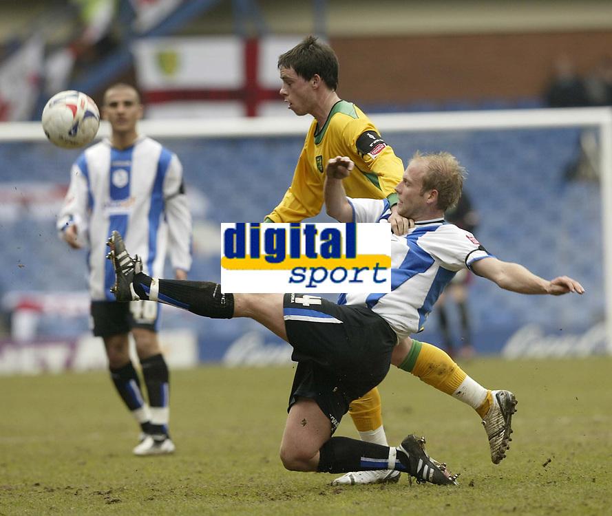 Photo: Aidan Ellis.<br /> Sheffield Wednesday v Norwich City. Coca Cola Championship. 15/04/2006.<br /> Sheffield's John Hills clears from Norwich's Ian Henderson