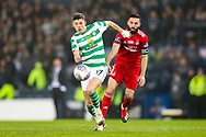 Ryan Christie (#17) of Celtic evades the challenge of Graeme Shinnie (#3) of Aberdeen during the Betfred Cup Final between Celtic and Aberdeen at Celtic Park, Glasgow, Scotland on 2 December 2018.