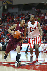 02 February 2013:  Jeff Early rushes by John Wilkins during an NCAA Missouri Valley Conference mens basketball game where the Salukis of Southern Illinois lost to the Illinois State Redbirds for Retro-Night 83-47 in Redbird Arena, Normal IL