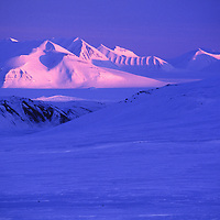 Midnight sun creeps across a mountain range on Norway's Spitsbergen Island, only 1,000 km from the North Pole.
