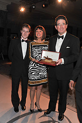 Left to right, Frankel's jockey TOM QUEALLY, LADY CECIL wife of Frankel's trainer Sir Henry Cecil and LORD GRIMTHORPE racing manager to Prince Khalid owner of Frankel - winner of the Cartier Award of Merit at the 22nd Cartier Racing Awards held at The Dorchester, Park Lane, London on 13th November 2012.