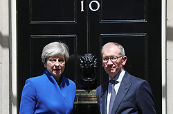 Prime Minister Theresa May, accompanied by her husband Philip, after making a statement in Downing Street after she traveled to Buckingham Palace for an audience with Queen Elizabeth II following the General Election results.