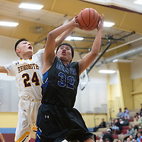 Navajo Pine Warrior Keishawn Nez (32) is fouled by Rehoboth Lynx Preston Hawthorne (24) under the basket  Tuesday evening in Rehoboth.