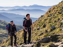 Two women walking towards the top of Txindoki during hiking tour