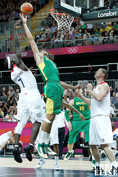 31 July 2012: Brazil Anderson Varejao vies for the rebound with Pops Mensah-Bonsu during 67-62 Team Brazil victory over Team Great Britain, during the men's basketball preliminary, at the Basketball Arena, in London, Great Britain.