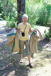 Amy Kvalseth Carrying Possums In Burlap Bags