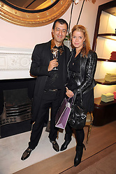 REZA MOKRI and SABINE ROEMER at a party to celebrate the publication of Shop Your Closet - the ultimate guide to organisingyour closet with style by Melanie Charlton-Fascitelli held at Asprey, New Bond Street, London on 16th September 2008.