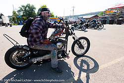 Tattoo and Motorcycle artist Darren McKeag leaving on Aidan's Ride from the Iron Horse Saloon during the Sturgis Black Hills Motorcycle Rally. Sturgis, SD, USA. Tuesday, August 6, 2019. Photography ©2019 Michael Lichter.
