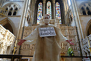 """Extinction Rebellion Penitents protest for climate change at Truro Cathedral in Cornwall at 11am on the 28th of August 2020 in Truro, United Kingdom. Based on the medieval idea of repenting transgressions against your community by wearing sackcloth and ashes whilst bearing your """"sins"""" around your neck. The Penitents performed in total silence in this highly visual ceremony. Starting at the Truro Park and Ride they travelled into Truro and walked in procession through the town before carrying out the ceremony. These protests are highlighting that the government is not doing enough to avoid catastrophic climate change and to demand the government take radical action to save the planet.<br /> <br /> Extinction Rebellion is a climate change group started in 2018 and has gained a huge following of people committed to peaceful protests. These protests are highlighting that the government is not doing enough to avoid catastrophic climate change and to demand the government take radical action to save the planet."""