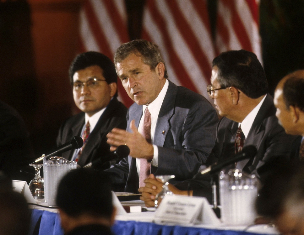 Bush at Border Governor's Conference in Brownsville, Texas  6-98 at left is Texas Secretary of State Albert Gonzalez<br /> ©Bob Daemmrich/The Image Works