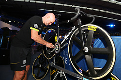 A mechanic repairs a bike during day six of the Six Day Series at Lee Valley Velopark, London