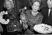 Iris Love and Brooke Astor with Just Desserts and Dolly Astor at a Dachund party. Barbetta. Manhattan. 12 February  1990. . © Copyright Photograph by Dafydd Jones 66 Stockwell Park Rd. London SW9 0DA Tel 020 7733 0108 www.dafjones.com