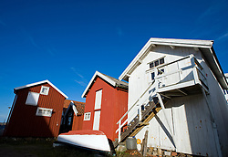 Wooden old boathouses at Grundsund village on Bohuslan coast in Sweden