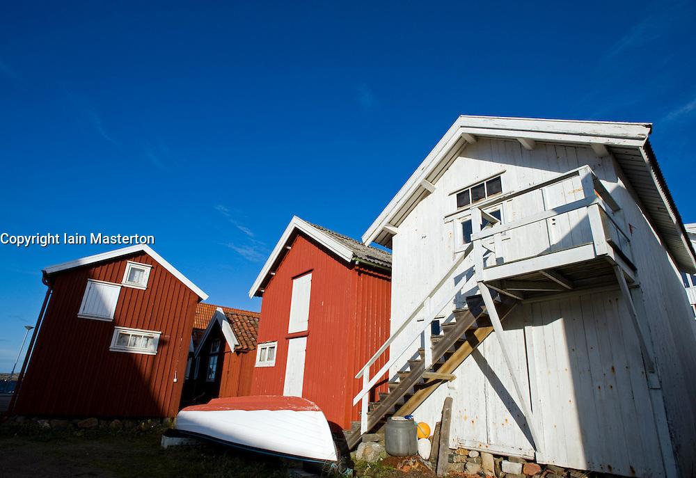 Wooden old boathouses at Grundsund village on Bohuslan coast in Sweden