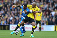Younes Kaboul of Watford holds on to  Callum Wilson of Bournemouth. Premier league match, Watford v AFC Bournemouth at Vicarage Road in Watford, London on Saturday 1st October 2016.<br /> pic by John Patrick Fletcher, Andrew Orchard sports photography.